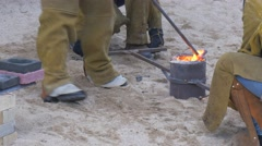 The Employee of a Foundry is Engaged in Clearing of a Metal Rod From a Dirt Stock Footage