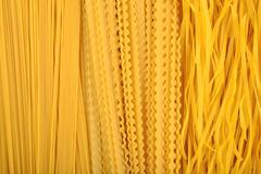 Assortment of uncooked Italian pasta as background - stock photo