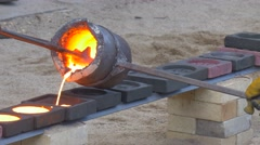 Iron Molding Men Pouring Molten Metal Into Molds Round and Square Shape Forms Stock Footage