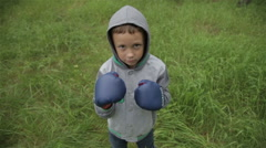 Boy in boxing gloves - stock footage