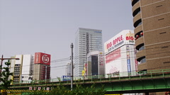 Chuo Line Passes Buildings in Akihabara Stock Footage