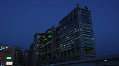 Fuji Television in Odaiba at Night Stock Footage