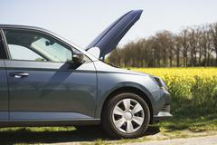 Cropped image of broken down car on roadside Stock Photos