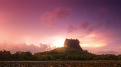 Sigiriya ancient rock in Sri Lanka. Travel destination amazing sunset landscape Stock Footage