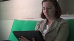 Woman working on a tablet Stock Footage