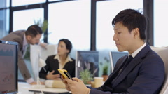 4K Cheerful business team in city office, man using computer tablet - stock footage