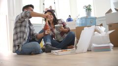Slow Motion Shot Of Couple Celebrating Moving Into New Home - stock footage
