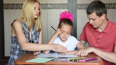 Parents show a child that she made mistakes doing homework Stock Footage
