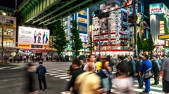 Tokyo - Night street view with people crossing street at Akihabara. Time lapse. Stock Footage