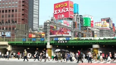 Tokyo - People on crosswalk with colorful billboards in background and traffic. - stock footage