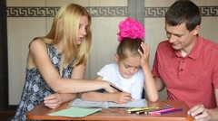 Parents corrected workbook which says their daughter schoolgirl Stock Footage