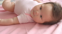 Baby Girl Laying On Pink Blanket Shot In Slow Motion Stock Footage