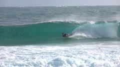 EDITORIAL SLOW MOTION: Young bodyboarder bodyboarding big tube barrel wave - stock footage