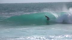 EDITORIAL SLOW MOTION: Pro boadyboarder boadyboarding big tube barrel wave Stock Footage