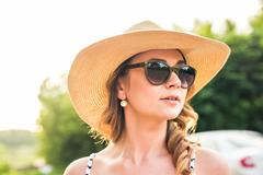 Woman in big straw hat enjoyed with summer sun Stock Photos