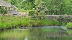 Picturesque stone bridge over the Bentley Brook, Peak District, England. 4K pan. Stock Footage