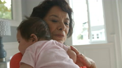 Grandmother Holding Baby Granddaughter Shot On R3D Stock Footage