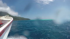 Boat ride in blue crystal clear open ocean waters of French Polynesia Stock Footage
