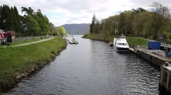 Fort Augustus Scotland UK where Caledonian canal meets Loch ness Stock Footage