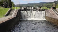 Water cascading through lock gates Caledonian Canal Fort Augustus Scotland UK Stock Footage