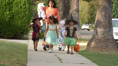 Children In Halloween Costumes Trick Or Treating Shot On R3D Stock Footage
