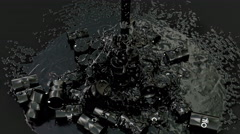 Fallen barrels of crude oil and fluid sim on black background 2 in 4k Stock Footage