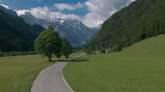Aerial - Road through the Logar Valley in spring, Slovenia Stock Footage