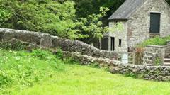 Ancient stone bridge in Milldale, Peak District, England. 4K camera pan R2L Stock Footage