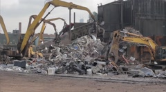 Wide shot of Cranes in a scrap yard Stock Footage