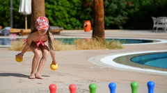 Little girl playing in a children's bowling Stock Footage