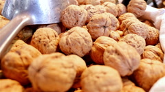 Whole walnuts at the La Boqueria food market, Barcelona, Spain Stock Footage