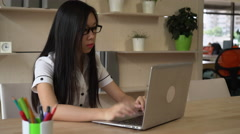Asian woman writing text on the computer Stock Footage