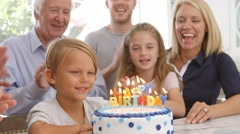 Boy Blows Out Candles On Birthday Cake, Slow Motion Stock Footage