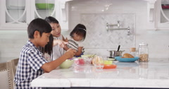 Busy Mother Organizing Children At Breakfast Shot On R3D - stock footage