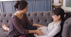 Pregnant Woman Being Examined At Home By Midwife Shot On R3D Stock Footage