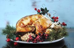 Scrumptious roast turkey chicken on platter - stock photo