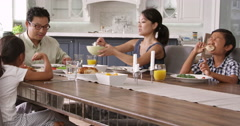 Family Eating Meal At Home Together Shot On R3D Stock Footage