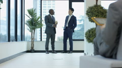 4K Corporate city businessmen chatting as they walk through office building Stock Footage