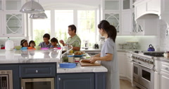Family Having Breakfast And Making Lunches Shot On R3D - stock footage