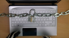 Cyber criminal stealing secrets with laptop - stock footage