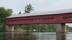 Detail of red, wooden covered bridge in Wakefield, Quebec. Stock Footage