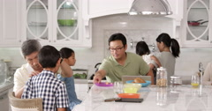 Extended Family Group Eating Breakfast At Home Shot On R3D Stock Footage
