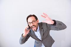 Furious man talking on phone Stock Photos