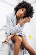 beauty young african american woman in bathrobe with tooth brush taking morning - stock photo