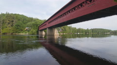 Wooden covered bridge and Gatineau river in Wakefield, Quebec. Stock Footage