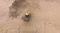 Aerial view of bulldozer pouring sand into truck Stock Footage