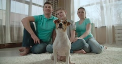 Cheerful family portrait with pet dog Jack Russell Terrier Stock Footage