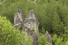 Eroded rocks in mountains Stock Photos