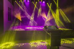 Sound mixer and stage in illuminated studio - stock photo