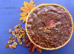 Traditional Thanksgiving Pecan Pie on Dark Blue Wood. - stock photo